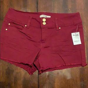 Maroon jean shorts, size 4. Refuge